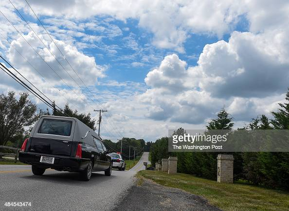The hearse makes it way down Walnut Drive following the funeral services for Lenny Robinson better known as the Route 29 Batman had for years dressed...