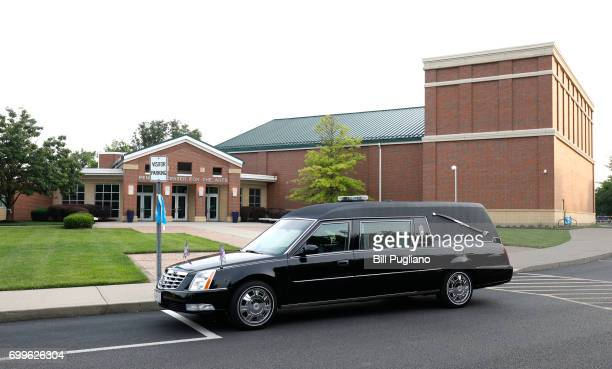 The hearse that brought Otto Warmbier to Wyoming High School for his funeral sits in front of Wyoming High School June 22 2017 in Wyoming Ohio...