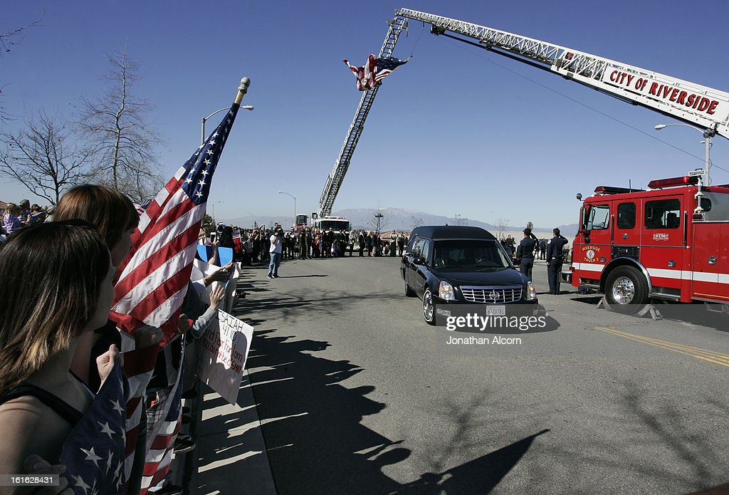 The hearse transporting slain Riverside police Officer Michael Crain leaves the funeral service at Grove Community Church in Riverside, California, February 13, 2013. Officer Crain was allegedly killed by ex LAPD officer Chris Dorner on February 7, 2013.