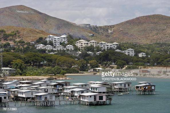 The heavily fortified whitewashed compound of the Australian High Commission staff known locally as 'Fort ShitScared' looks down on the Motuan stilt...
