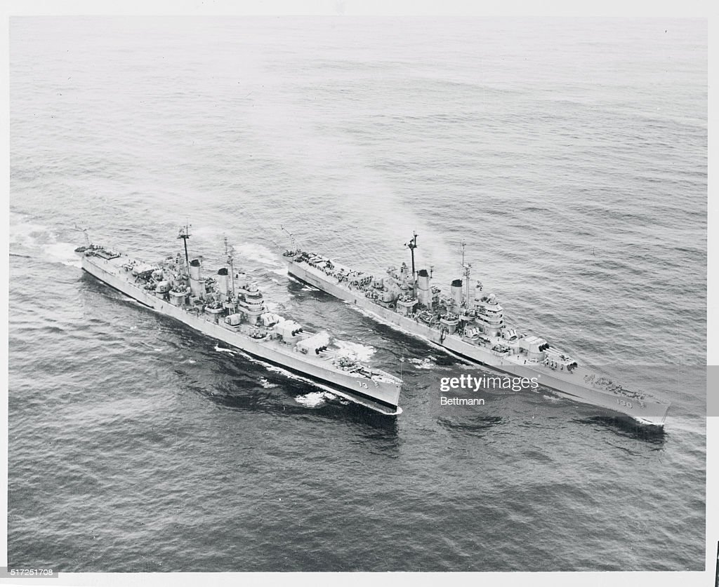 The heavy cruisers USS Saint Paul left and USS Bremerton steam toward North Korean coast on one of their last shore bombardment missions on August 2...