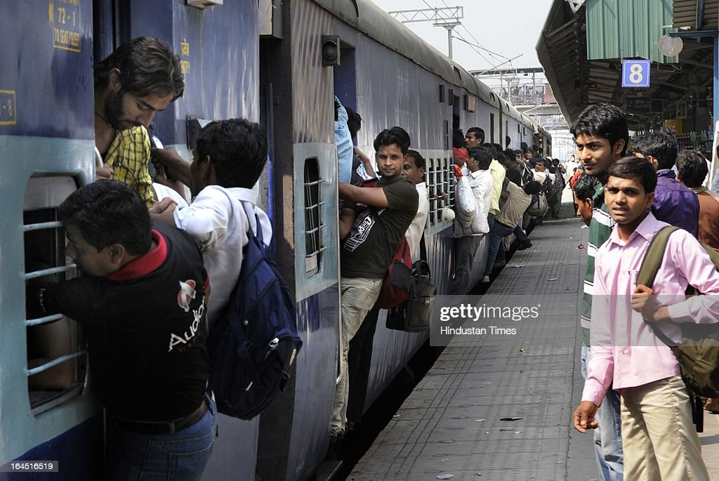 The heavy rush of train passengers due to Holi festival at New Delhi Railway Station on March 24, 2013 in New Delhi, India. Holi, the Hindu festival of colors, will be celebrated across the country on March 27.