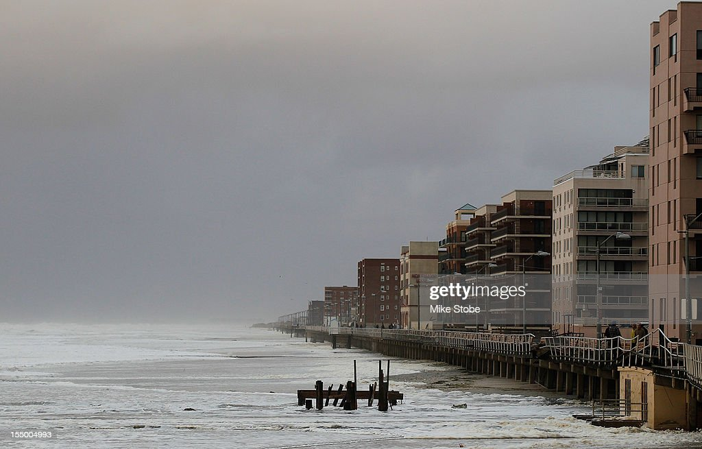 The heavy surf breaks against the boardwalk on October 30 2012 in Long Beach New York The storm has claimed at least 33 lives in the United States...