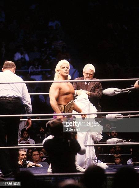 The Heavy Weigh Champion 'Nature Boy' Rick Flair enters the ring with JJ Dillon before the Heavy Weight bout against Road Warrior Hawk during the...