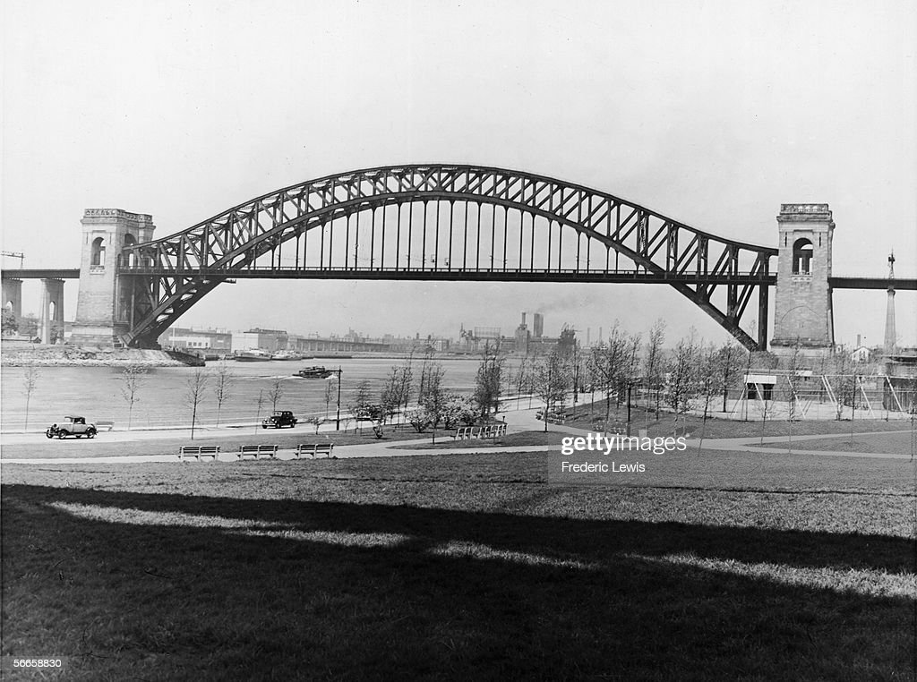 The Hell Gate Bridge over a part of the East River called Hell Gate which separates Astoria Queens from Ward's Island as seen over Shore Boulevard...