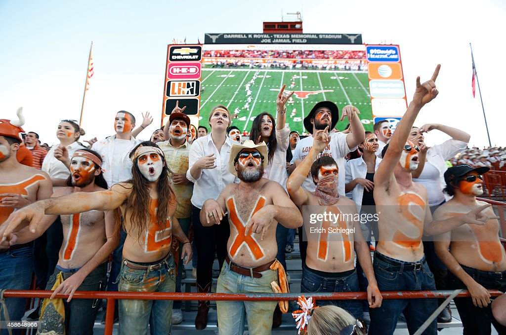 The 'Hellraiser' student cheering section prepare for the kickoff in the NCAA Big 12 game between the Texas Longhorns and the West Virginia...