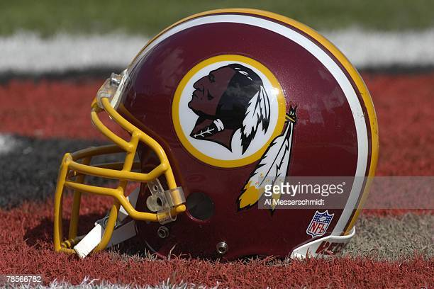 The helmet of a Washington Redskins player rests on the field during warm ups against the Tampa Bay Buccaneers at the Raymond James Stadium on...