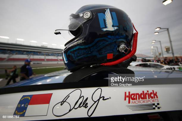 The helmet of Dale Earnhardt Jr driver of the Nationwide Chevrolet sits on top of his car during qualifying for the Monster Energy NASCAR Cup Series...