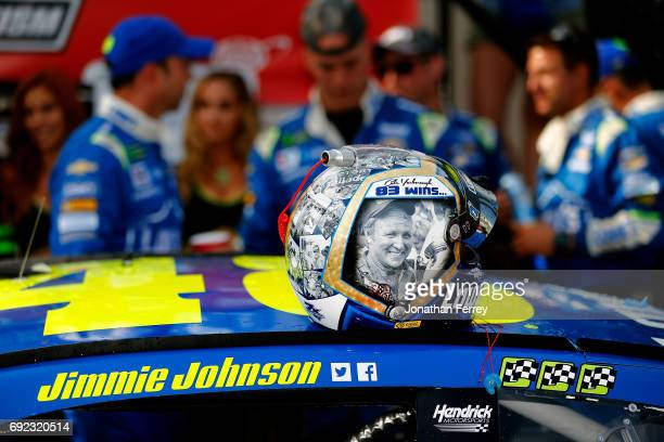 The helmet of Jimmie Johnson sits on top of the Lowe's Chevrolet after winning the Monster Energy NASCAR Cup Series AAA 400 Drive for Autism at Dover...