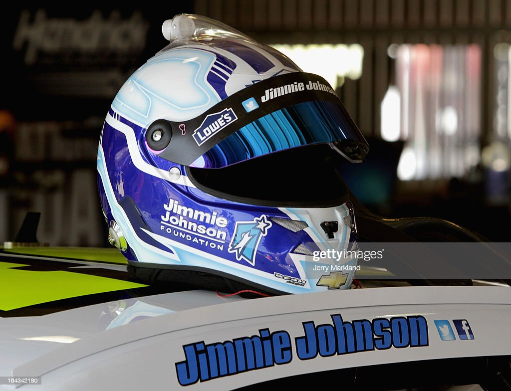 The helmet of Jimmie Johnson sits on top of the #48 Lowe's/Jimmie Johnson Foundation Chevrolet in the garage area during practice for the NASCAR Sprint Cup Series Auto Club 400 at Auto Club Speedway on March 22, 2013 in Fontana, California.