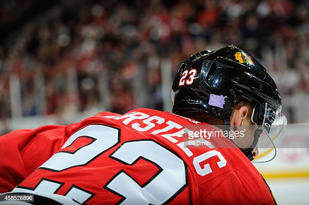 The helmet of Kris Versteeg of the Chicago Blackhawks has the Hockey Fights Cancer logo during the NHL game against the Ottawa Senators on October 26...