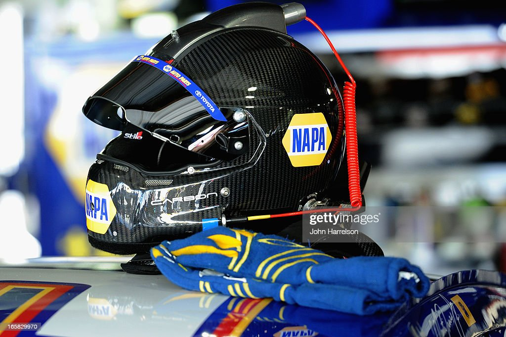 The helmet of Martin Truex Jr., driver of the #56 NAPA Auto Parts Toyota, sits on top of his car in the garage area during practice for the NASCAR Sprint Cup Series STP Gas Booster 500 on April 6, 2013 at Martinsville Speedway in Ridgeway, Virginia.
