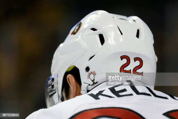The helmet of Ottawa Senators center Chris Kelly sports the Stick By Nik logo for Nicholle Anderson wife of Ottawa Senators goalie Craig Anderson...