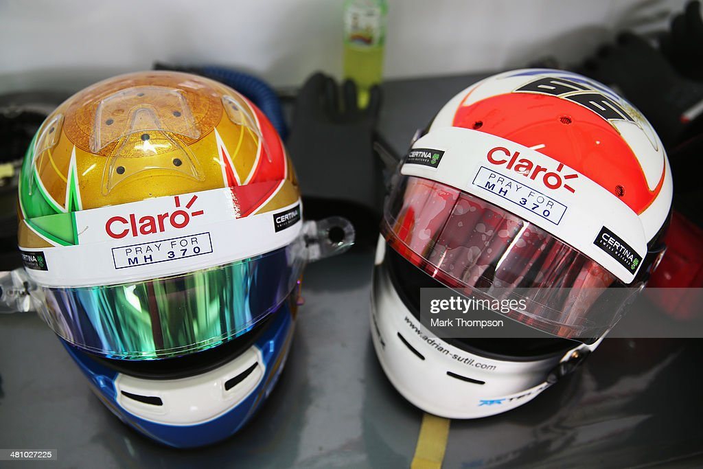 The helmets belonging to Esteban Gutierrez of Mexico and Sauber F1 (L) and Adrian Sutil of Germany and Sauber F1 show an inscription in memory of Malaysian Airlines flight MH370 during practice for the Malaysia Formula One Grand Prix at the Sepang Circuit on March 28, 2014 in Kuala Lumpur, Malaysia.