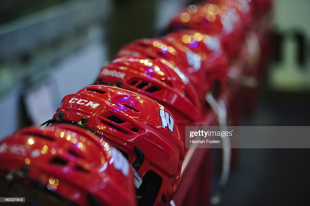 The helmets for the Wisconsin Badgers sit on the bench before the semifinal game of the Big Ten Men's Ice Hockey Championship between the Wisconsin Badgers and the Penn State Nittany Lions on March 21, 2014 at Xcel Energy Center in St Paul, Minnesota.