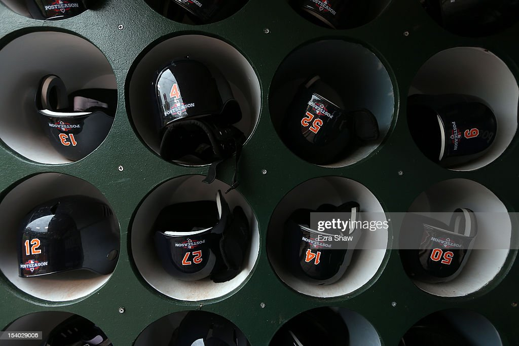 The helmets of the Detroit Tigers in the dugout before their game against the Oakland Athletics Game Five of the American League Division Series at Oakland-Alameda County Coliseum on October 9, 2012 in Oakland, California.
