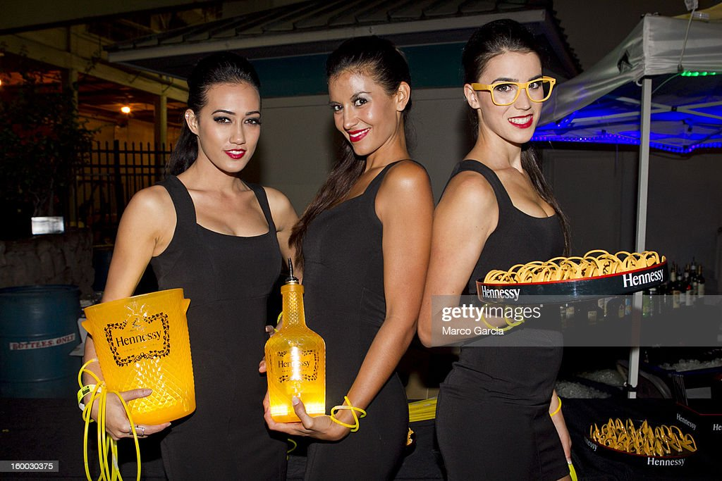 The Hennessy V.S. girls model with products before the start of the 2 Chainz concert at Aloha Tower Marketplace on January 24, 2013 in Honolulu, Hawaii.
