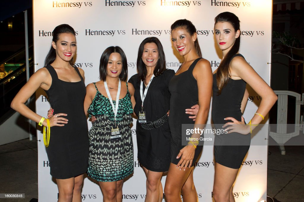 The Hennessy V.S. girls model with Thuy Anh Nguyen and Maria O'Connor before the start of the 2 Chainz concert at Aloha Tower Marketplace on January 24, 2013 in Honolulu, Hawaii.