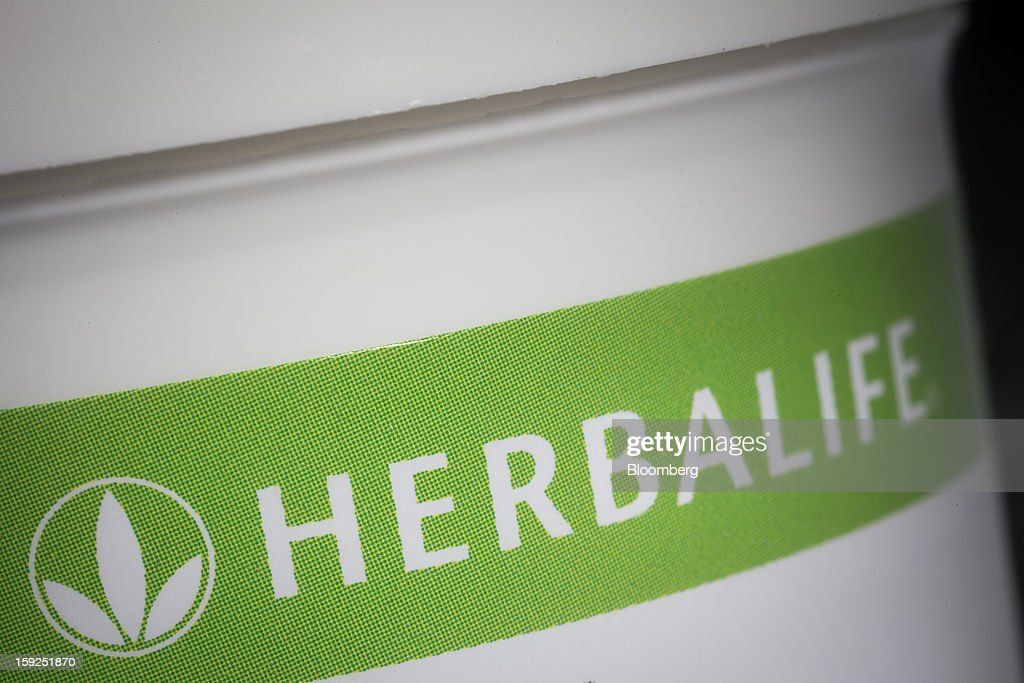 The Herbalife Ltd. logo is seen on a product arranged for a photograph in New York, U.S., on Thursday, Jan. 10, 2013. Timothy Ramey, an analyst at D.A. Davidson & Co., said that Herbalife Ltd. has a legal corporate structure, rejecting hedge-fund manager Bill Ackman's theory that the direct-selling company operates as a pyramid scheme. Photographer: Scott Eells/Bloomberg via Getty Images