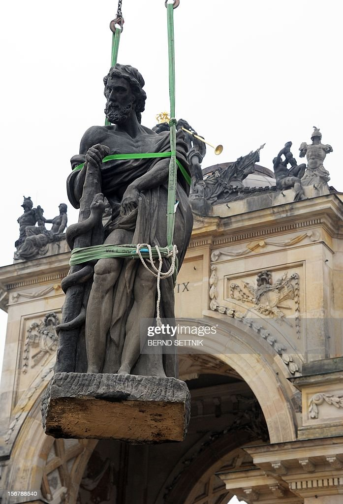 The Hercules statue of the colonnade of the New Palace is assembled in Potsdam, eastern Germany, on November 21, 2012. 1.2 million euros have been spent for the restauration of the sand stone statues.
