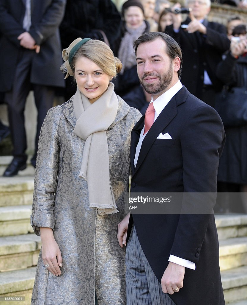 The hereditary Grand-Duke of Luxembourg, Prince Guillaume (R), and his wife Belgian Countess Stephanie de Lannoy pose in front of the Saint Epvre Basilica before the wedding of Archduke of Austria Christoph of Habsbourg with Adelaide Drape-Frisch, on December 29, 2012 in Nancy. AFP PHOTO / JEAN-CHRISTOPHE VERHAEGEN
