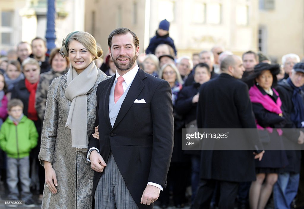 The hereditary Grand-Duke of Luxembourg, Prince Guillaume (R), and his wife Belgian Countess Stephanie de Lannoy pose in front of the Saint Epvre Basilica before the wedding of Archduke of Austria Christoph of Habsbourg with Adelaide Drape-Frisch, on December 29, 2012 in Nancy.