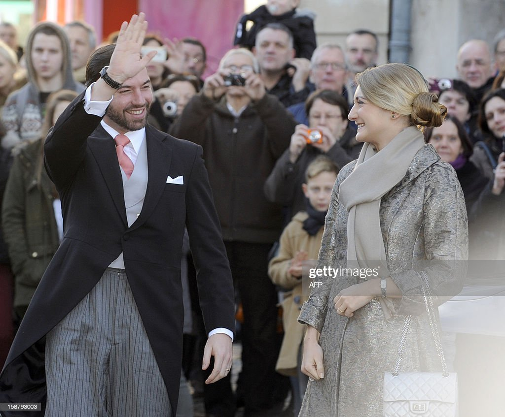 The hereditary Grand-Duke of Luxembourg, Prince Guillaume (L), and his wife Belgian Countess Stephanie de Lannoy pose in front of the Saint Epvre Basilica before the wedding of Archduke of Austria Christoph of Habsbourg with Adelaide Drape-Frisch, on December 29, 2012 in Nancy.