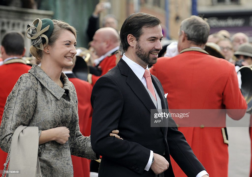 The hereditary Grand-Duke of Luxembourg, Prince Guillaume (R) and his wife Belgian Countess Stephanie de Lannoy leave the Saint Epvre Basilica after the wedding of Archduke of Austria Christoph of Habsbourg-Lorraine and Archduchess Adelaide Drape-Frisch, on December 29, 2012, in Nancy.