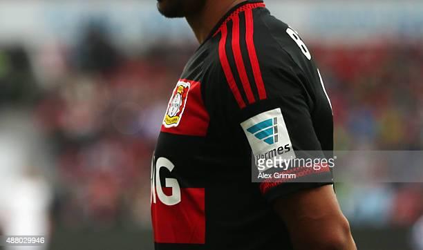 The Hermes logo is seen on the jersey of Karim Bellarabi of Leverkusen during the Bundesliga match between Bayer Leverkusen and SV Darmstadt 98 at...