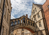 The Hertford Bridge also known as The Bridge of Sighs joins Hertford College over New College Lane at Oxford University in Oxford England