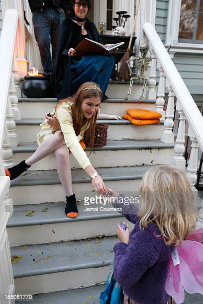 The Herzog family of Clinton Hill Brooklyn give candy to 'trick or treaters' as Brooklyn residents participate in Halloween activities on October 31...