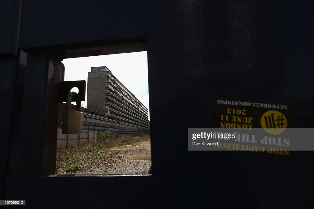 The Heygate Estate is seen through security boarding in the Walworth area on April 24, 2013 in London, England. The Heygate estate in central London was built in 1974 as social housing and housed around 3000 people, but fell into a state of disrepair, gaining a reputation for crime and poverty. The estate is due to be demolished as part of the £1.5billion GBP 'Elephant & Castle regeneration scheme', and replaced with 2,500 'affordable' new homes. The area has become popular with street artists, storytellers, and guerilla gardeners and attracts an array of urban wildlife including bats, birds and mammals.