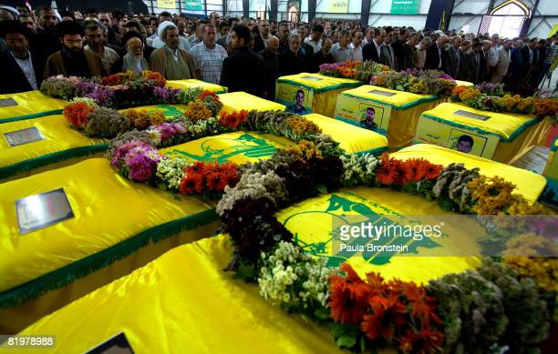 The Hezbollah community gather to pay their respect by the coffins of the eight militants killed in the 2006 war July 18 2008 in the southern suburbs...