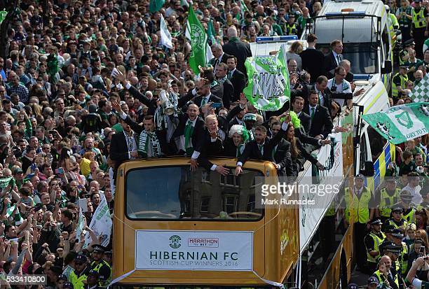 The Hibernian FC team celebrate winning the Scottish Cup yesterday against Rangers FC as they parade the Scottish Cup to their fans on an open top...