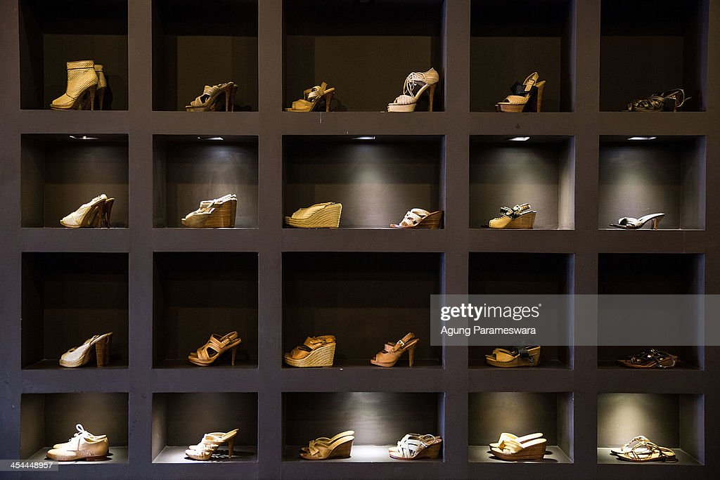The high heels,wedges and flat shoes collection are seen in display at Niluh Djelantik store on November 12, 2013 in Seminyak, Bali, Indonesia. Niluh Djelantik (formerly called Nilou), the hand made high end leather shoe, is produced by Balinese shoe lover and designer Ni Luh Ayu Pertami with 40 shoes designers and workers in a small atelier at Canggu Village. This brand signature by a unique engraving and designed to be comfortable high heels or wedges with elegan touch. Celebrities like Cate Blanchett, Uma Thurman,Julia Roberts ,Paris Hilton, Cameron Diaz and American top model Gisele Bundchen have been known to purchase Niluh Djelantik beautiful shoes and sandals.