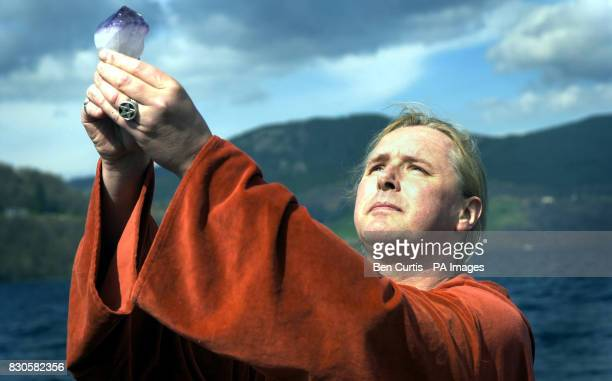 The High Priest of British White Witches Kevin Carlyon from Hastings East Sussex casts a spell from a boat on the waters of Loch Ness to protect the...