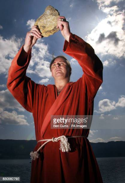 The High Priest of British White Witches Kevin Carlyon from Hastings East Sussex holds a talisman as he casts a spell to protect the fabled Loch Ness...