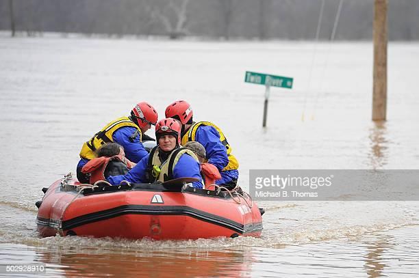The High Ridge Fire Department performs a water rescue to evacuate a stranded resident on December 30 2015 in Eureka Missouri The St Louis area and...