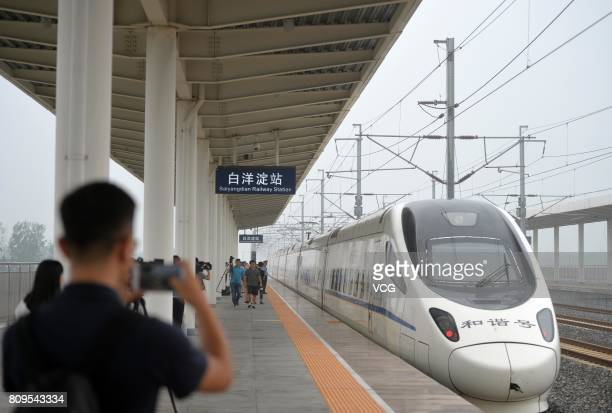 The high speed train D6655 from Beijing sets out from Baiyangdian Railway Station in Xiongan New Area on July 6 2017 in Baoding Hebei Province of...