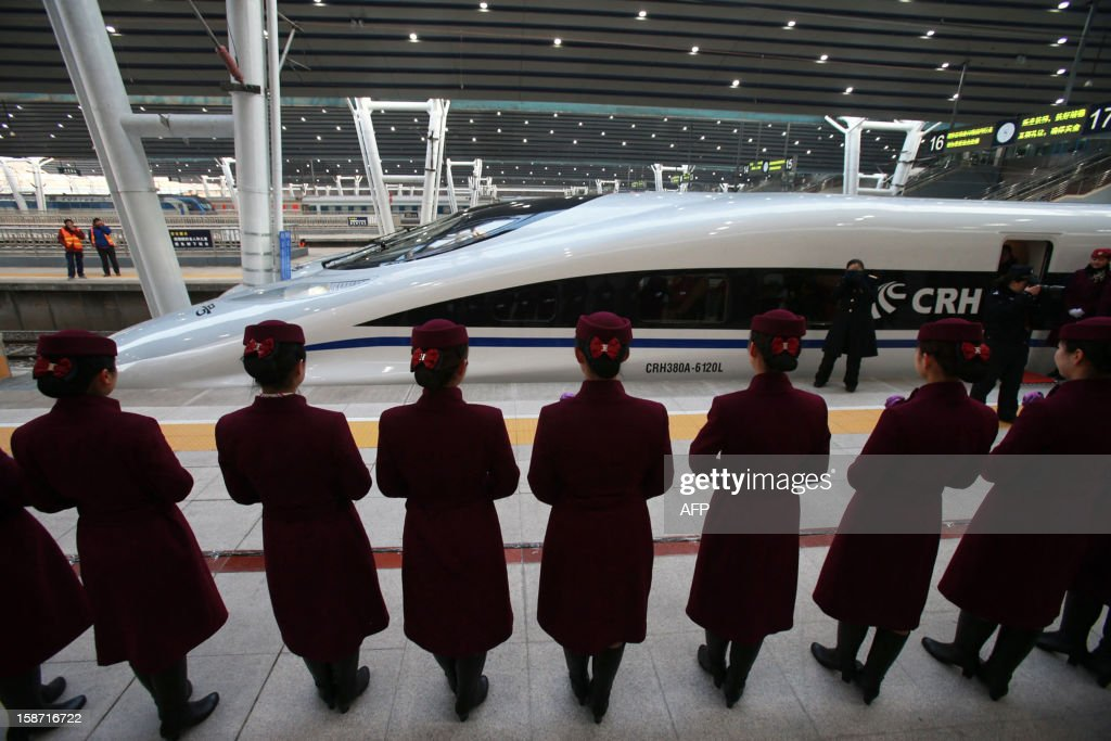 The high speed train of the new 2,298-kilometre (1,425-mile) line between Beijing and Guangzhou waits to start its journey in Beijing on December 26, 2012. China started service on December 26 on the world's longest high-speed rail route, the latest milestone in the country's rapid and -- sometimes troubled -- super fast rail network. The opening of this new line means passengers will be whisked from the capital to the southern commercial hub in just eight hours, compared with the 22 hours previously required. CHINA