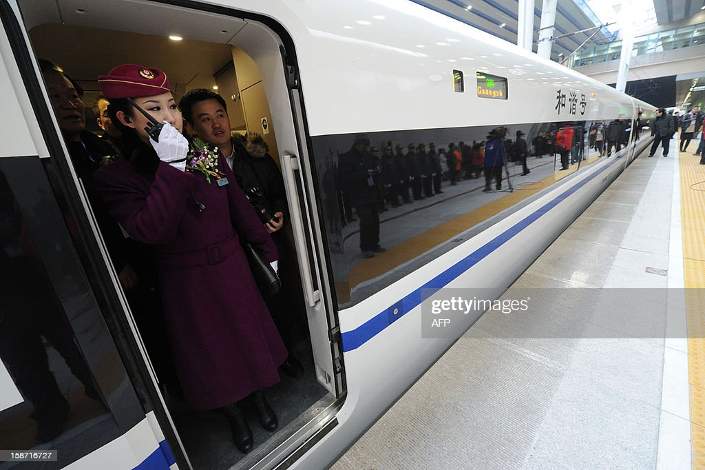 The high speed train of the new 2,298-kilometre (1,425-mile) line between Beijing and Guangzhou waits to start off in Beijing on December 26, 2012. China started service on December 26 on the world's longest high-speed rail route, the latest milestone in the country's rapid and -- sometimes troubled -- super fast rail network. The opening of this new line means passengers will be whisked from the capital to the southern commercial hub in just eight hours, compared with the 22 hours previously required. CHINA
