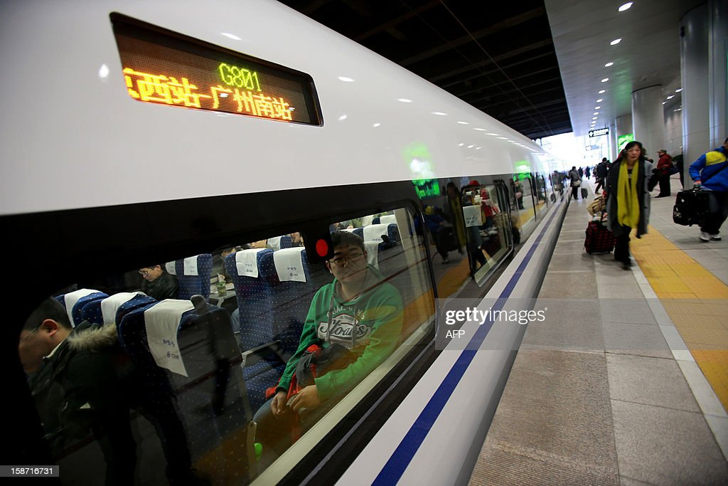 The high speed train of the new 2,298-kilometre (1,425-mile) line between Beijing and Guangzhou awaits to its journey in Beijing on December 26, 2012. China started service on December 26 on the world's longest high-speed rail route, the latest milestone in the country's rapid and -- sometimes troubled -- super fast rail network. The opening of this new line means passengers will be whisked from the capital to the southern commercial hub in just eight hours, compared with the 22 hours previously required. CHINA OUT AFP PHOTO