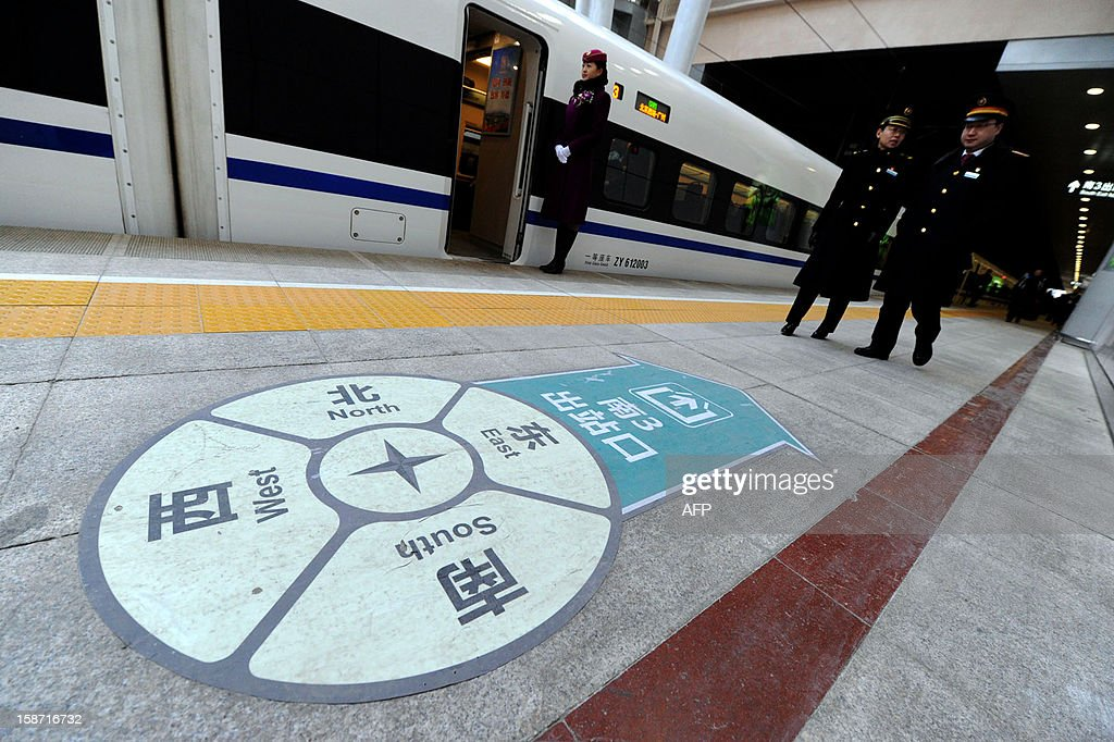 The high speed train of the new 2,298-kilometre (1,425-mile) line between Beijing and Guangzhou waits to begin its journey in Beijing on December 26, 2012. China started service on December 26 on the world's longest high-speed rail route, the latest milestone in the country's rapid and -- sometimes troubled -- super fast rail network. The opening of this new line means passengers will be whisked from the capital to the southern commercial hub in just eight hours, compared with the 22 hours previously required. CHINA