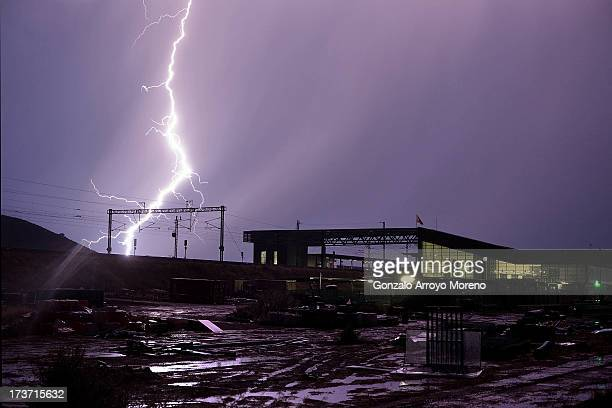 The high speed train overhead power cable is struck by lightning close to Villena AVE station during a summer storm on July 10 2013 in Villena Spain...