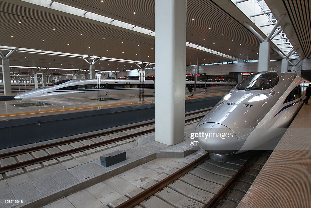 The high speed train that runs on the new 2,298-kilometre (1,425-mile) line between Beijing and Guangzhou stops at a train station in Zhengzhou, central China's Henan province on December 26, 2012. China started service on December 26 on the world's longest high-speed rail route, the latest milestone in the country's rapid and -- sometimes troubled -- super fast rail network. The opening of this new line means passengers will be whisked from the capital to the southern commercial hub in just eight hours, compared with the 22 hours previously required. CHINA OUT AFP PHOTO