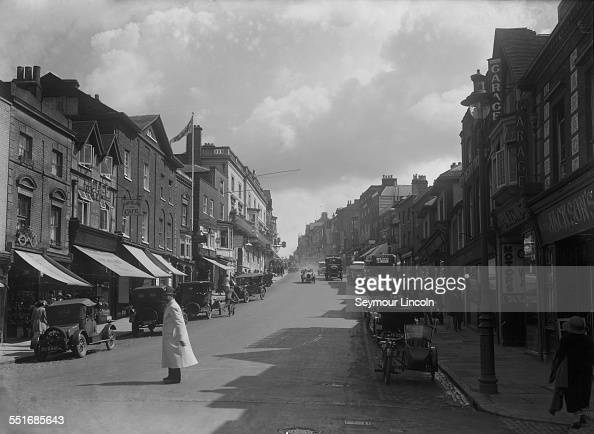 The High Street in Guildford Surrey circa 1925 On the left is the Astolat Olde Tea Shoppe and on the right Jackson's garage
