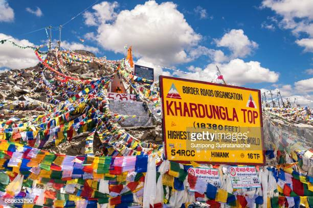 The highest road in the world Khardung La pass, India. Khardung La is a high mountain pass located in the Ladakh region of the Indian state of Jammu and Kashmir