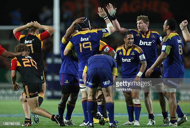 The Highlanders celebrate their win during the round one Super Rugby match between the Chiefs and the Highlanders at Waikato Stadium on February 25...