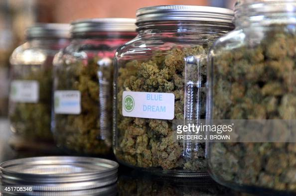 The highlyrated strain of medical marijuana 'Blue Dream' is displayed among others in glass jars at Los Angeles' firstever cannabis farmer's market...