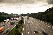 The highway (ring) around Antwerp in Belgium with cars and speed signals